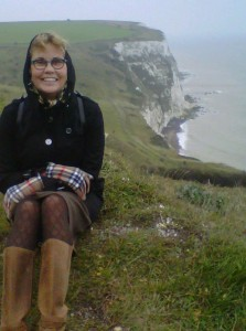 Woman seated overlooking White Cliffs of Dover