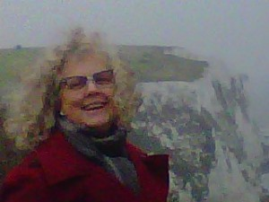 Laughing woman overlooking the White Cliffs of Dover