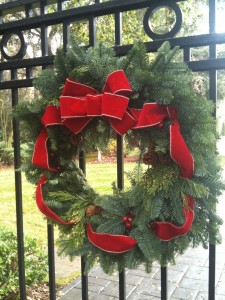 Evergreen wreath with gold trimmed ribbon